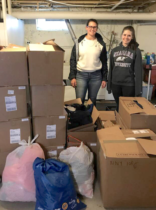 Niagara University social work students collected supplies for local agencies with which they performed outreach. Pictured are Emma Simoneaux and Chloe Flickinger, who helped to deliver the items.