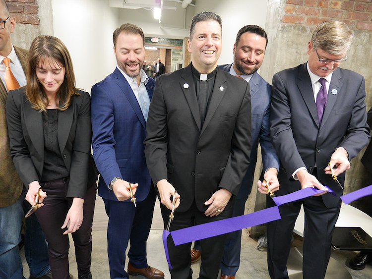 Entrepreneur Sarah Battaglia, founder of Olive Ridley Paints; New York State Sen. Rob Ortt; the Rev. James J. Maher, C.M., Niagara University president; Anthony Vilardo, president of USA Niagara Development Corp.; and Paul Dyster, mayor of the City of Niagara Falls, cut the ribbon on TReC, a new co-working incubation space in Niagara Falls operated by NU's Niagara Global Tourism Institute.