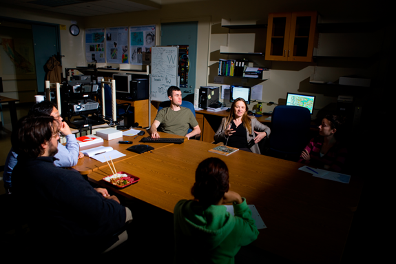 University at Buffalo researcher Beata Csatho (center, in blazer and black shirt) leads a meeting with her research group on UB's North Campus. From 2011-14, Csatho, a renowned climate scientist and chair of UB's department of geology, headed the science definition team that helped determine the scientific requirements of NASA's ICESat-2 satellite. (Photo credit: Douglas Levere/University at Buffalo)