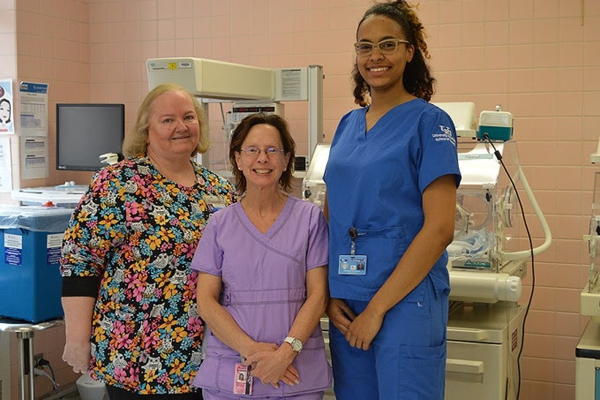 UB nursing professor Deborah Raines, Sisters Hospital nurse Tracey Zimmerman and nursing student Stephanie Rodriguez in the maternal-newborn unit at Sisters of Charity Hospital. (Photo credit: Carrie Sette-Camara)