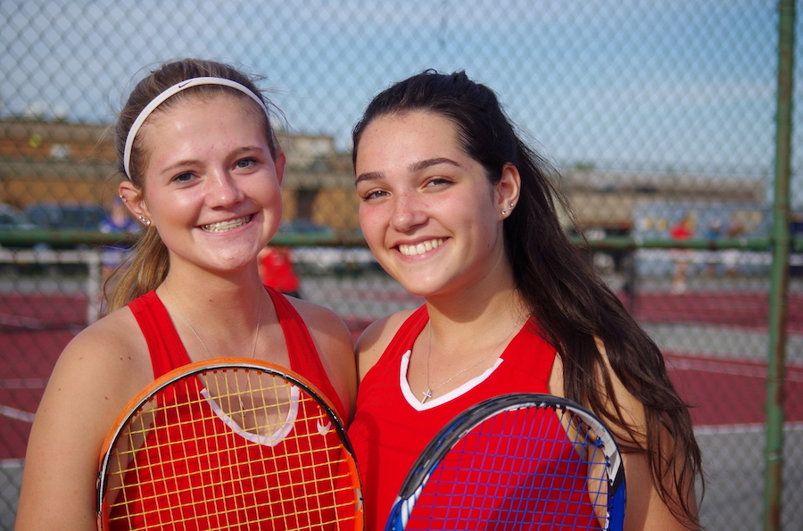Katelyn Hoover, left, a senior, and Gabriela `Gabbie` Greene, also a senior, defeated Grand Island in a double's contest the two played on Thursday night.