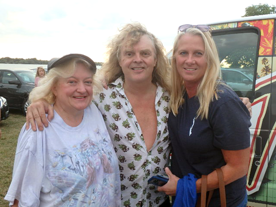 Above, singer/songwriter and performer Carl Dixon poses with fans Kim D'Angelo, right, and Jill Downie of Niagara Falls. Dixon also is shown on stage.