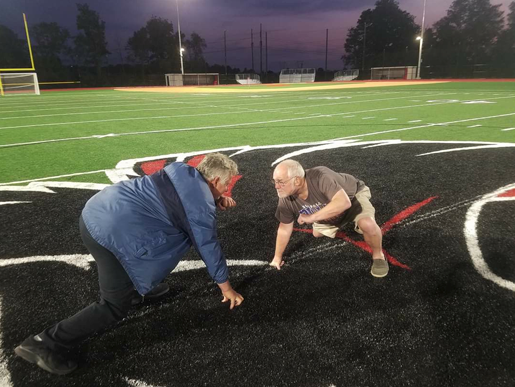 Niagara Wheatfield alumni Gary Strenkoski, left, and Dan Wendt line up on the spiffy new field. (Photo credit: Dan Wendt)