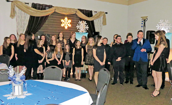 Members of the Matt's Music vocal performance team prepare to sing two songs in front of the crowd at the 2018 Snowflake Ball.