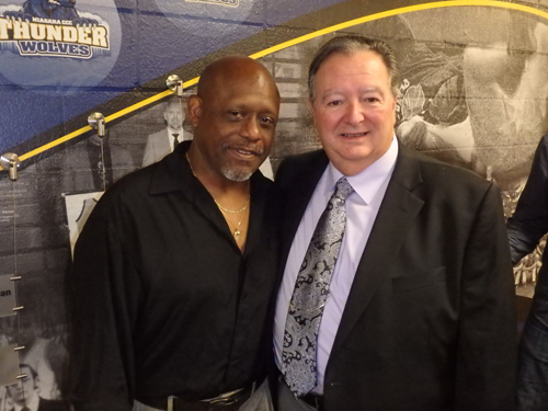 Willie Moore, wrestler champion, left, stands with Town of Niagara Supervisor Lee Wallace. Both are inductees on the NCCC Athletic Wall of Fame.