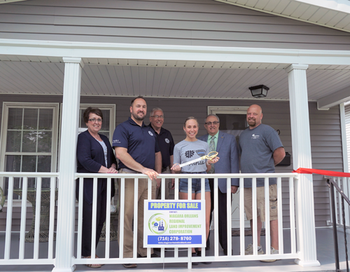 Pictured from left: North Tonawanda 2nd Ward Alderwoman Donna Braun; Niagara County Legislator Rich Andres; NT Alderman-at-Large Robert Pecoraro; new homeowner Jessica Saraceno; North Tonawanda Mayor Arthur Pappas; and John Saraceno, owner of Saraceno Construction Inc.