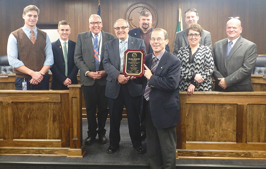 Former alderman Mark Berube receives a plaque from NT's Common Council and Mayor Art Pappas.