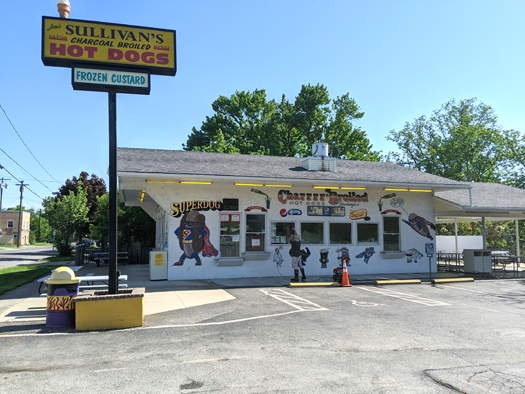 A worker sprays the outside of Sullivan's Hot Dogs in Niagara Falls as the restaurant gets set to open for outdoor eating.
