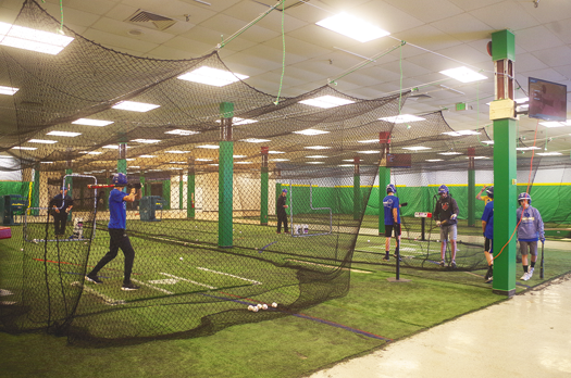 Players use the batting cages in the old Sears building of the Summit Mall in Wheatfield.