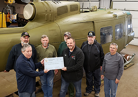 Legislator Jesse Gooch gives Tom Kontac $2000 check from the Niagara County Legislature. Back row, left to right, Jeff Kasper, Jim Huntz, Greg Mish, Harold Ball and Lee Chase.