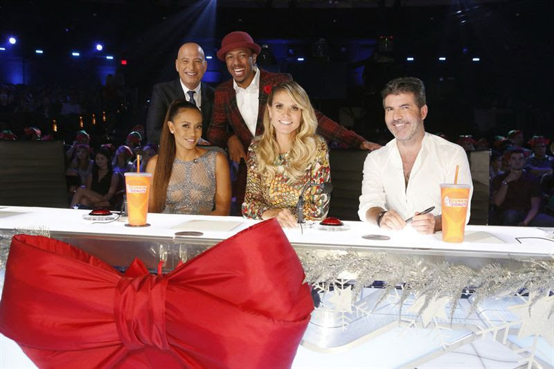`America's Got Talent` host Nick Cannon, standing center, with judges Howie Mandel, Mel B, Heidi Klum and Simon Cowell. A two-hour special will air at 8 p.m. ET/PT on Dec. 19. (NBC photo)