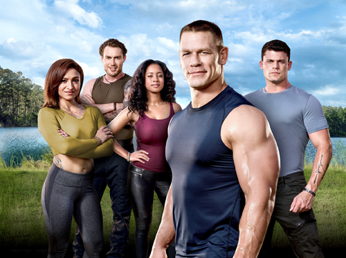 `American Grit`: From left, Cadre members Riki Long, Grady Powell, Chloe Mondesir, host John Cena and cadre member John Burk. On Sunday, June 11, the WWE Superstar brings 17 new competitors - all who either have lost their grit or never had it - to sunny Hampton Island. There, Cena and an elite group of military heroes will live alongside these people, all in search of a change, and take them under their wing as they lead them through a series of all-new epic team and individual challenges. In the end, only one competitor will win a quarter of a million dollars, but hopefully, all of them will find their grit. (FOX photo by Michael Becker)