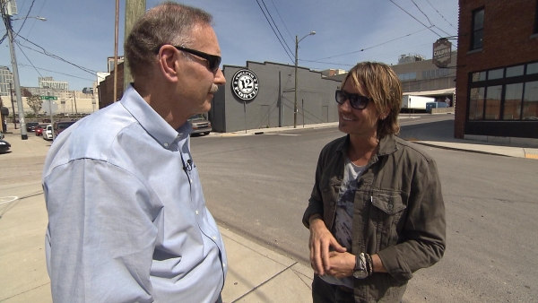 "John Blackstone listens to Keith Urban in an interview for ""CBS Sunday Morning."""