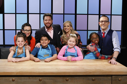 Junior chefs pose with judges Monti Carlo, Scott Conant and Sarah Michelle Gellar, and host Ted Allen on Food Network's