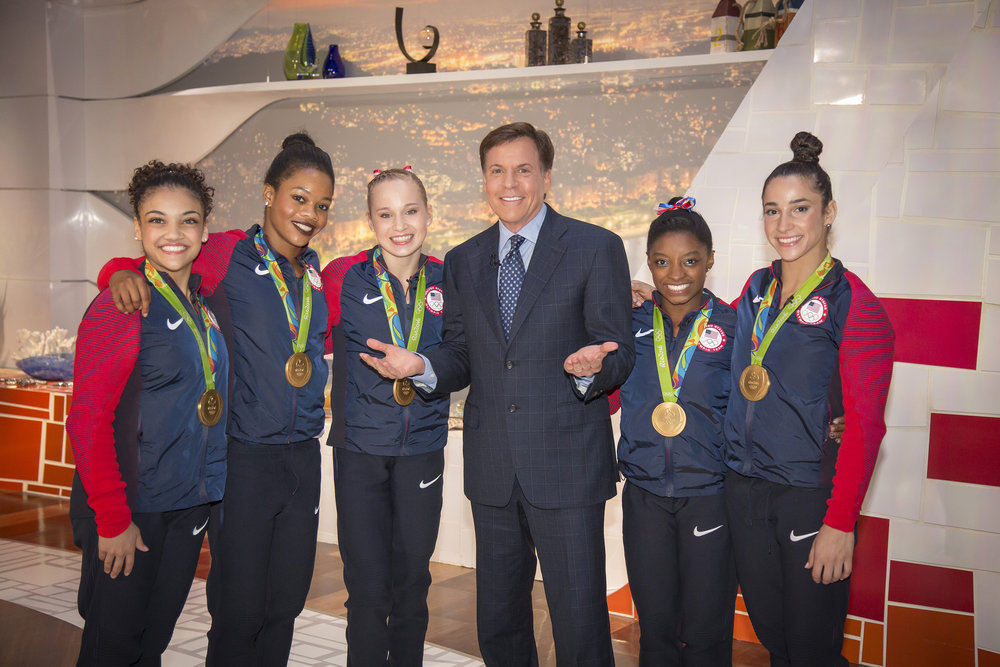 Bob Costas with `The Final Five.` From left: Laurie Hernandez, Gabby Douglas, Madison Kocian, Simone Biles and Aly Raisman. (NBC photo by Paul Drinkwater/NBC)