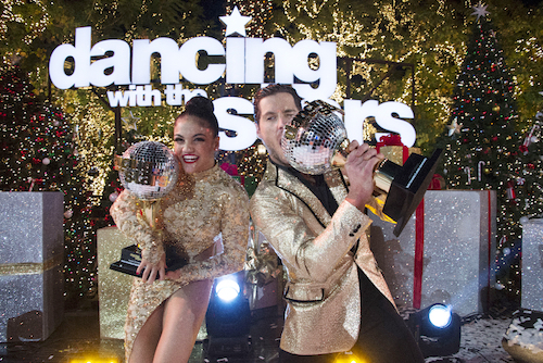 Laurie Hernandez and Valentin Chmerkovskiy celebrate winning `Dancing with the Stars.` (ABC photo by Eric McCandless)
