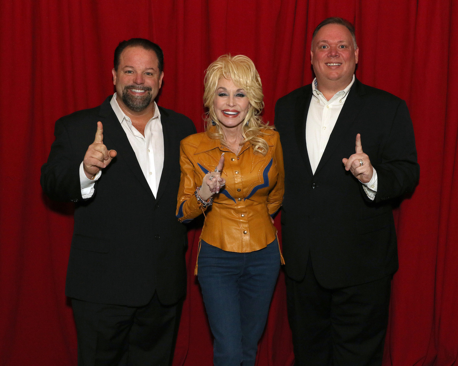 From left, Danny Nozell, CEO, CTK Management; Dolly Parton; and Kirt Webster, president/CEO, Webster Public Relations.