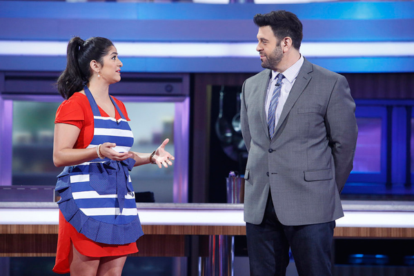 `Food Fighters`: Pictured, from left: home cook Jacky Herrera and host Adam Richman. The series is back for season two. (NBC photo by Greg Gayne)