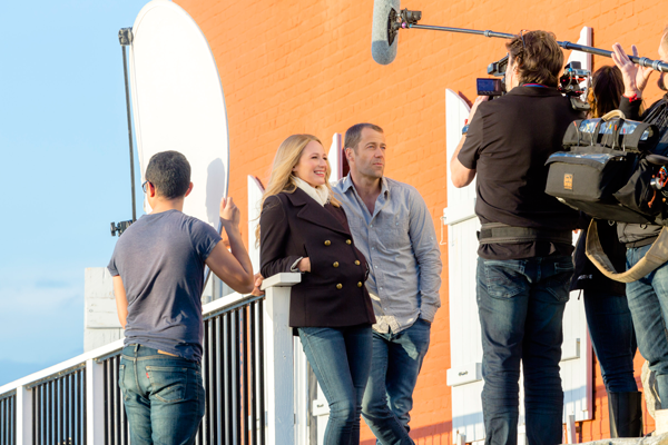 Jewel and Colin Ferguson are shown on the set of `Framed for Murder: A Fixer Upper Mystery.` (©2016 Crown Media United States LLC photo by Ryan Plummer)