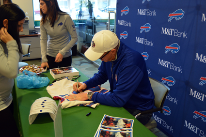 Jim Kelly signs autographs for fans at M&T Bank's Military Road branch. (Photos by Lauren Zaepfel)