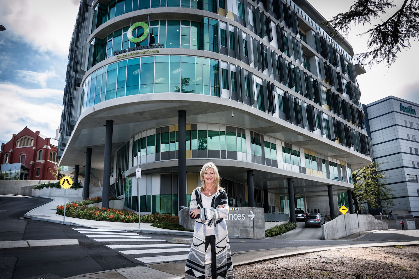 Olivia Newton-John stands outside of the Olivia Newton-John Cancer Wellness and Research Centre in the performer's hometown of Melbourne, Australia.