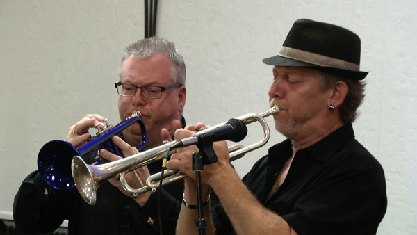 Robin Pegg and Jim Nowaczewksi from the polka bank Phocus. (Jim is wearing the hat.) The band members include: Nowaczewski, Bob Wroblewski, Mike Melymuka, Pegg, Mike Kurdziel, Bryan Kurdziel, Steve Brown, Dave `Berg` Rozanski and Jim Kaminski.