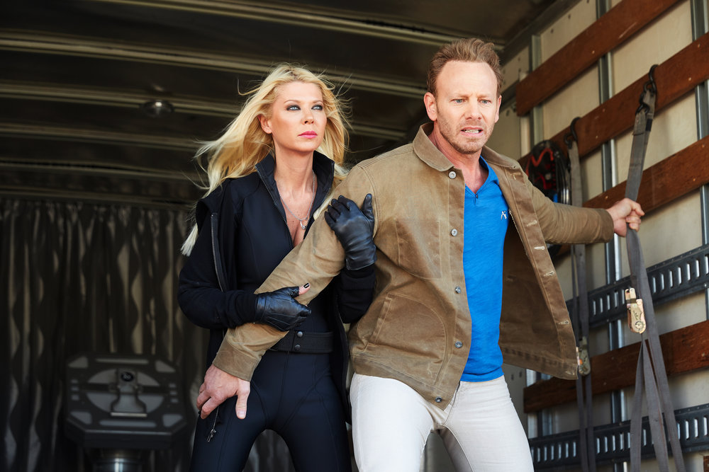 Tara Reid as April Shepard and Ian Ziering as Fin Shepard in `Sharknado: The 4th Awakens.` The duo will return in the fifth installment. (Syfy photo by Tyler Golden)