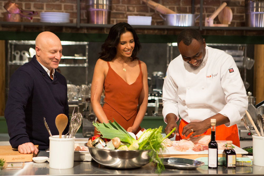 `Top Chef`: Tom Colicchio and Padma Lakshmi speak with cheg Gerald Sombright. (Bravo photo by Paul Cheney)