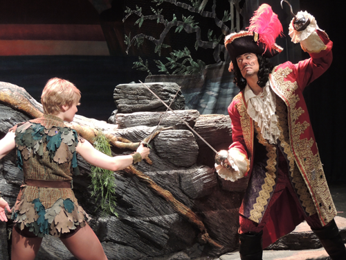 Peter Pan (Hayley Podschun) fights Captain Hook (John Bolton).