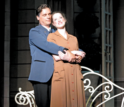 The Captain and Maria (Paul Todaro and Emilie Renier) share a moment together in `The Sound of Music.`