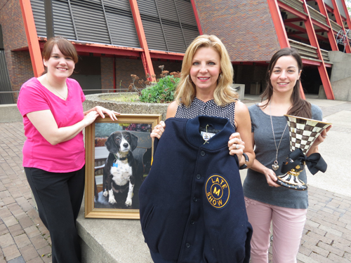 Pictured from left, Artpark's Katie Miller and Maria Costello Hays join gala chairwoman Laurie Lisowski Frey (center) in displaying some of the items guests can bid on as part of a special auction.