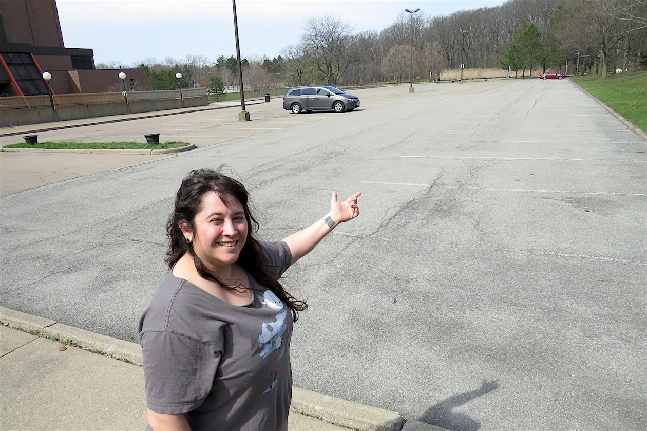 NOW: Artpark & Company Director of Visual Arts & Family Programs Tanis Winslow points to a part of the parking lot that will be transformed next month into