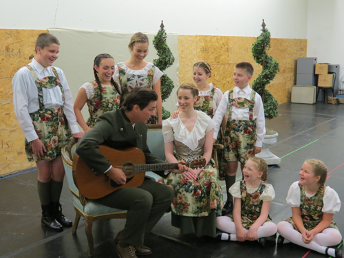 Pictured rehearsing `The Sound of Music,` from left, standing: Joe Greenan as Friedrich, Jessica Roloff as Louisa, Tessa Mossey as Liesl, Gabrielle Petrosino as Brigitta and Sam Fesmire as Kurt. Seated, from left: Paul Todaro as Captain, Emilie Renier as Maria, Faith Walh as Gretl and Paige Hergott as Marta. (photo by Joshua Maloni)