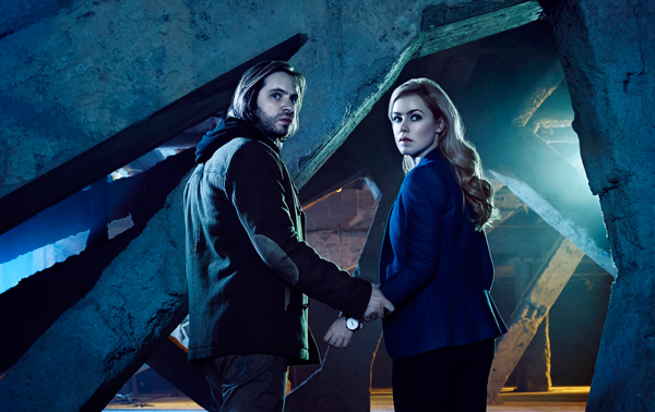 `12 Monkeys`: Pictured, from left, are stars Aaron Stanford as James Cole and Amanda Schull as Dr. Cassandra Railly. (Syfy photo by Jeff Riedel)