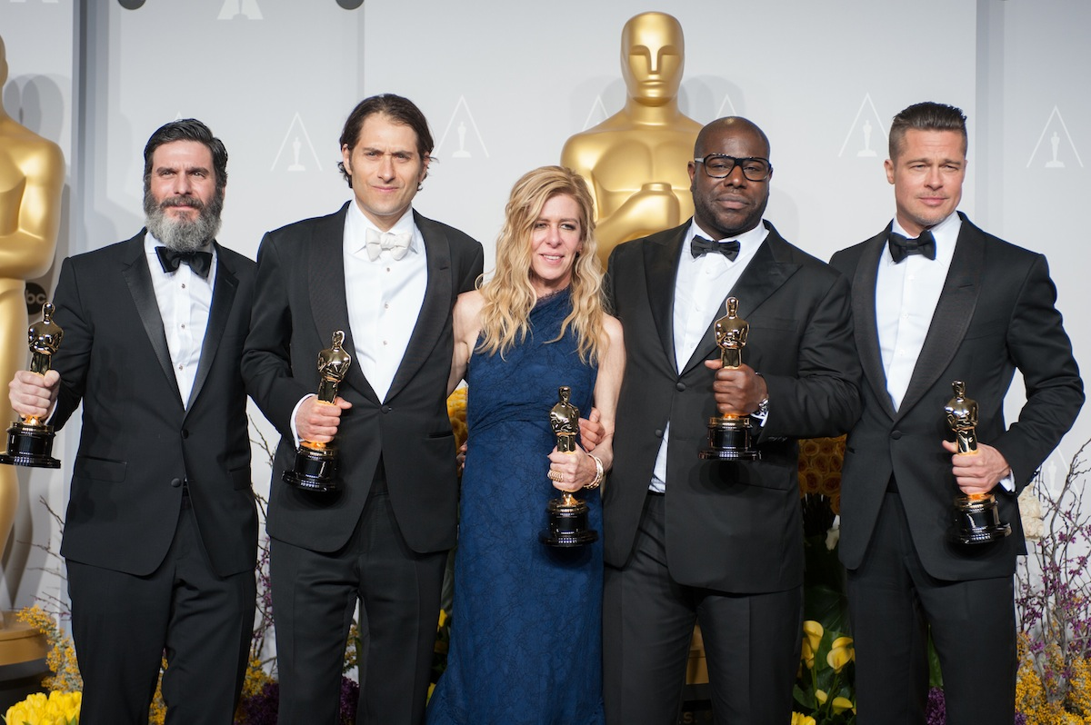 After winning the category Best Motion Picture of the Year for `12 Years a Slave`, producers Anthony Katagas, Jeremy Kleiner, Dede Gardner, Steve McQueen and Brad Pitt pose backstage with their Oscars for the press. (photo by Johnny Vy/©A.M.P.A.S.)