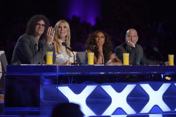`America's Got Talent`: Pictured, from left, are judges Howard Stern, Heidi Klum, Mel B and Howie Mandel. (NBC photo by Virginia Sherwood)