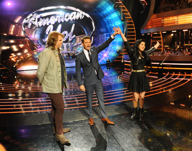 `American Idol XIII`: Jena Irene wins the coin toss and elects to perform first on the finale. She is pictured with Caleb Johnson (left) and Ryan Seacrest. (FOX photo by Michael Becker)