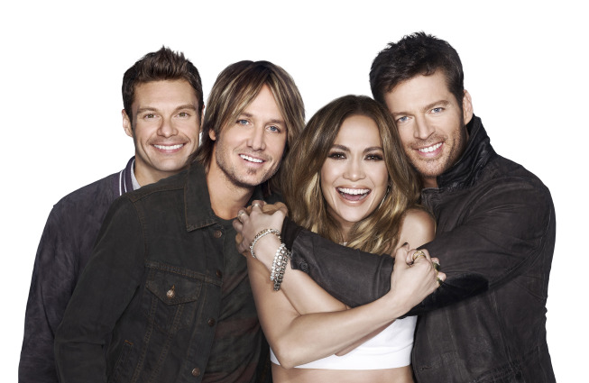 `American Idol XIII`: Pictured from left is host Ryan Seacrest alongside judges Keith Urban, Jennifer Lopez and Harry Connick Jr. (FOX photo by Michael Becker; copyright 2013 FOX Broadcasting Co.)