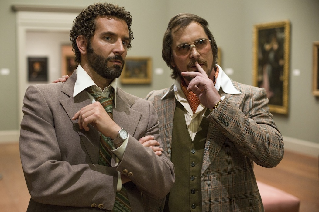 Richie Dimaso (Bradley Cooper, left) and Irving Rosenfeld (Christian Bale) talk in a gallery at the Frick Museum in Columbia Pictures' `American Hustle.` (photo by Francois Duhamel ©2013 Annapurna Productions LLC/all rights reserved)