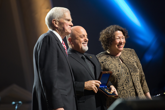 Billy Joel (center) receives the Library of Congress Gershwin Prize for Popular Song from Dr. James H. Billington, the librarian of Congress (left) and U.S. Supreme Court Justice Sonia Sotomayor (right). (photo by Joe Shymanski)