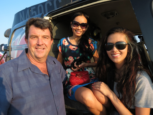 "Craig Hosking, left, poses with his wife, Kelly Mac (center), and his stepdaughter, Michelle, inside the ""Need for Speed"" helicopter. (photo by Joshua Maloni)"