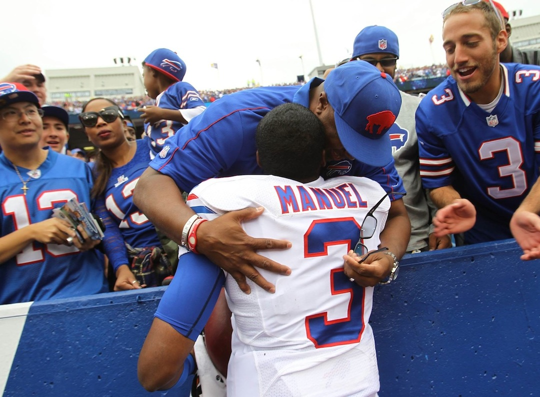 E.J. Manuel takes a moment to celebrate with his father following Sunday's win over the Carolina Panthers. (photo by Jim McCoy/Buffalo News, courtesy of WBBZ)