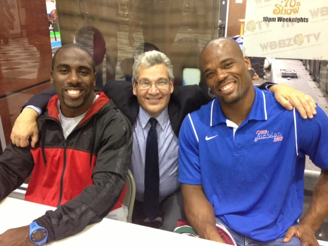 Bob Koshinski, center, poses with C.J. Spiller (left) and Fred Jackson.