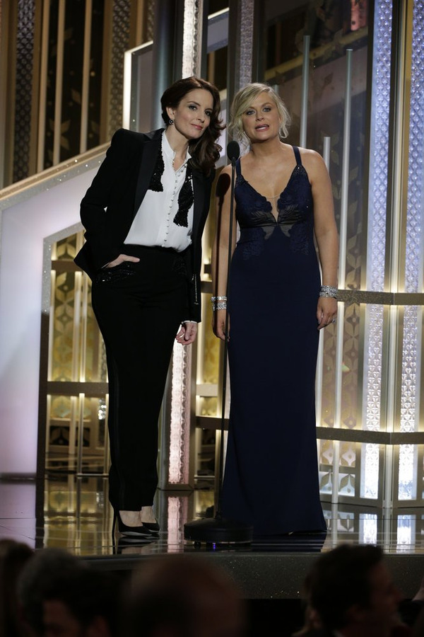 Tiny Fey, left, and Amy Poehler, hosted the 72nd Annual Golden Globe Awards at the Beverly Hilton Hotel Sunday. (NBC photo by Paul Drinkwater)