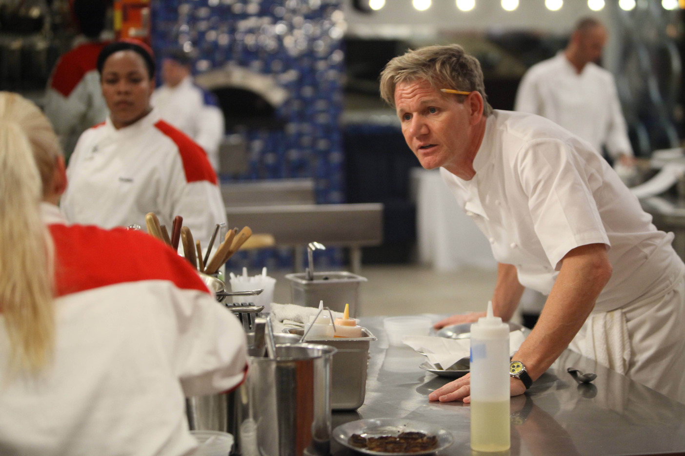 `Hell's Kitchen`: Chef Gordon Ramsay is shown with some of the season 12 competitors. The new season begins this fall on FOX. (photo by Patrick Wymore/FOX).