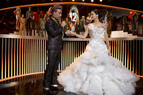 Caesar Flickerman (Stanley Tucci) and Katniss Everdeen (Jennifer Lawrence) in `The Hunger Games: Catching Fire.` (Lionsgate Publicity photo by Murray Close)