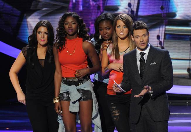 `American Idol`: Host Ryan Seacrest explains Kree Harrison, Amber Holcomb, Candice Glover and Angie Miller are all safe from elimination. (FOX photo by Ray Mickshaw; copyright: FOX)