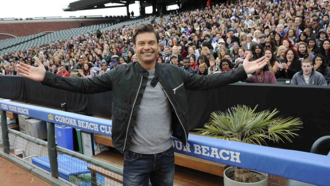 `American Idol XIII`: Host Ryan Seacrest is shown at the recent San Francisco auditions. Behind him, thousands gathered for a chance to become the next `American Idol` champion. (FOX photo by David Moir)