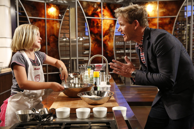 `Junior MasterChef`: A new culinary competition series for talented kids between the ages of 8 and 13 who love to cook will premiere on FOX. Pictured: Gordon Ramsay with a `Junior MasterChef` contestant. (FOX photo by Greg Gayne; copyright: FOX)