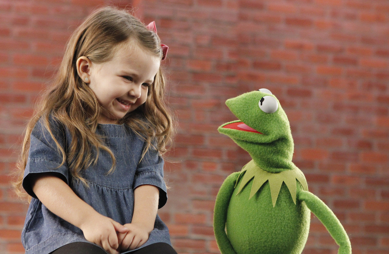 Kermit the Frog with a young fan.